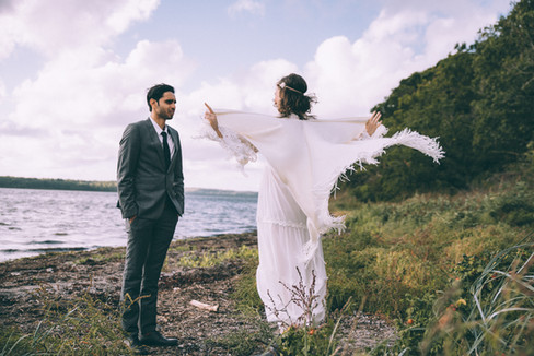 A couple bonding and having fun by the beach whole on getting married in Denmark