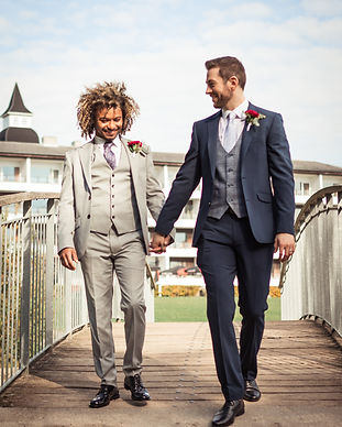 A gay couple walking across the bride during their same sex wedding in Denmark