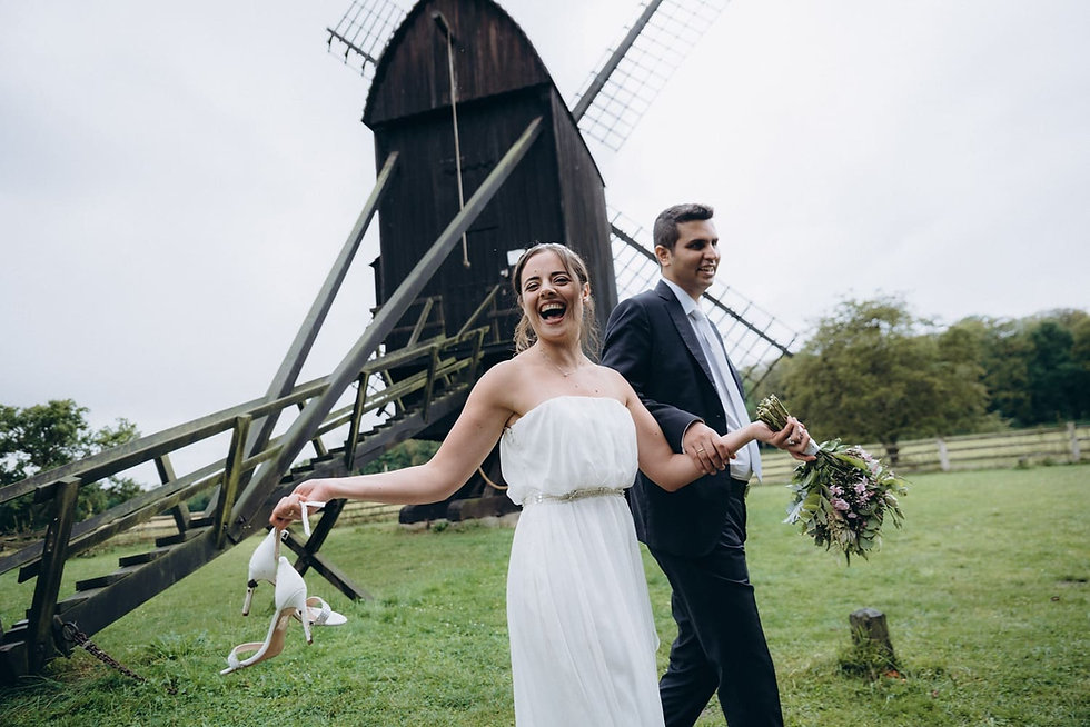 A couple laughing during their open-air wedding in Denmark, a charming venue for your small intimate wedding abroad.