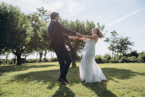 Husband and wife dancing and spinning in circles while having fun getting married in Denmark during their small wedding abroad.