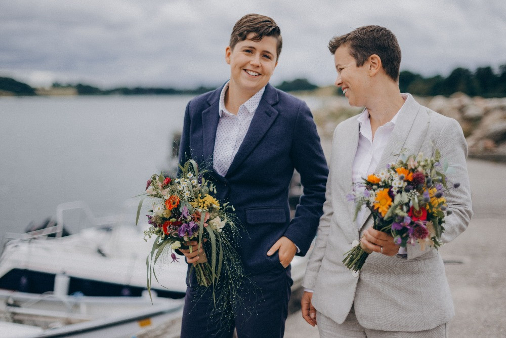 Happy lesbian couple which got married in Denmark in the forest