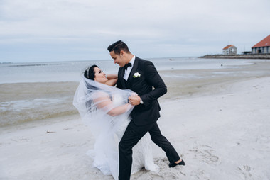 Husband and wife dancing during their Scandinavian beach wedding on Lolland Island, booked with one of our Denmark wedding packages for overseas weddings.