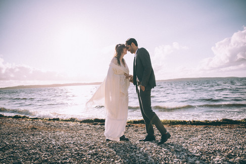 A bride and groom enjoying their Denmark beach wedding during their inanimate elopement abroad.