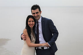 Newlyweds on the Danish beach posing in camera after they got married in Denmark.