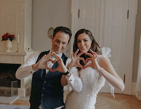 Newlyweds shows the heart with fingers