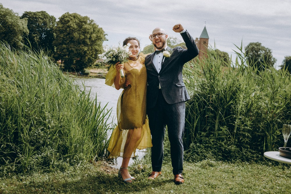 Happy couple at the Maribo lake after their marriage in Denmark