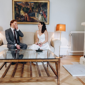 Laughing and talking inside the Vindeholme Castle, these newlyweds are enjoying their small castle wedding experience in the Danish Islands.
