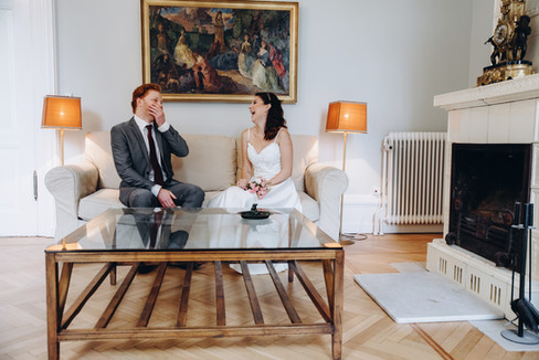 A joyous moment between bride and groom at the Vindeholme Castle during their Denmark elopement.