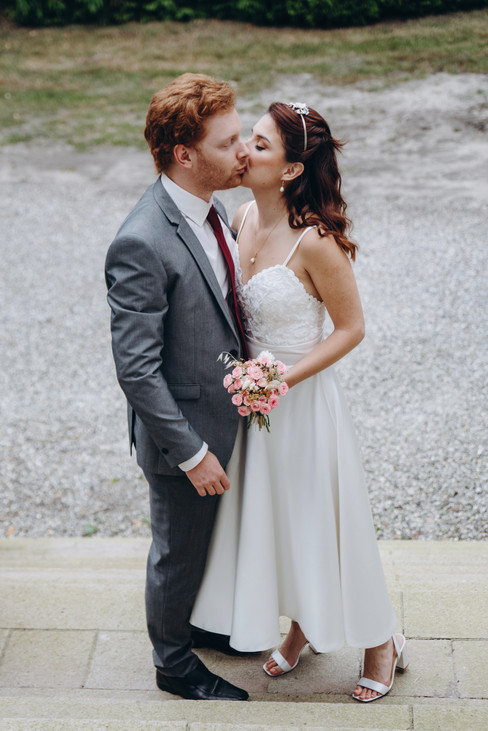 The bride and groom kissing during their elopement in Denmark as they get married at the Vindeholme Castle, a top Denmark wedding venue.