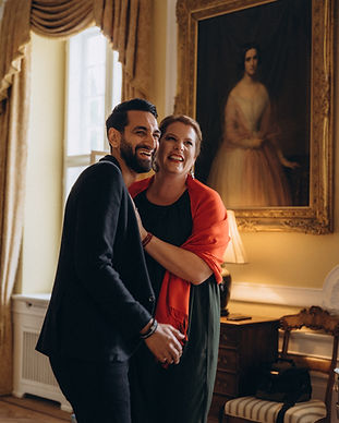 A couple smiling at the Lungholm Castle in Lolland Island as they renew wedding vows abroad in Denmark.