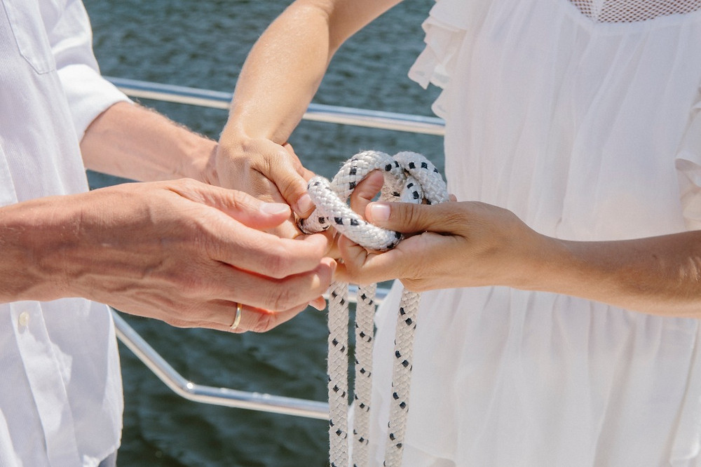 A picture of the hand fasting ceremony when elope abroad