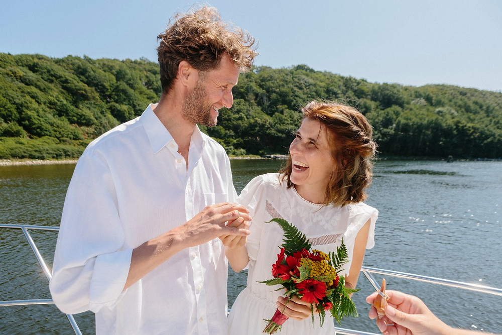 The couple exchanging rings at their all inclusive elopement abroad on Bornholm