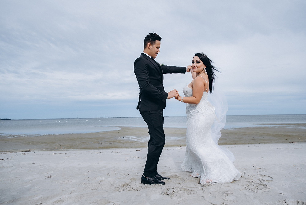 A couple dancing on the beach during their intimate adventure beach wedding in Denmark.