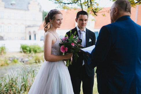 Bride and groom during their island wedding ceremony at Lolland-Falster while getting married in Denmark.