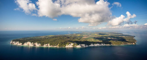 An aerial view of Møn Island and the cliffs spanning across the Baltic Sea, a top destination for an adventure wedding abroad to Denmark.