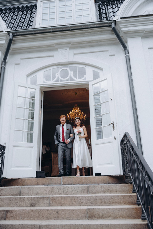 Newlyweds during their Scandinavian wedding at the Vindeholme Castle, a wedding venue you can include in your wedding packages abroad for two.