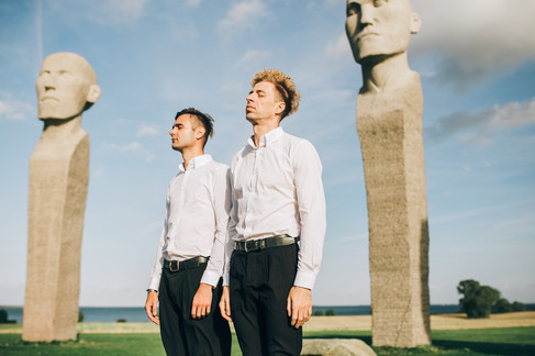Two grooms at the Dodecalith in Denmark as they enjoy their LGBT wedding abroad in style