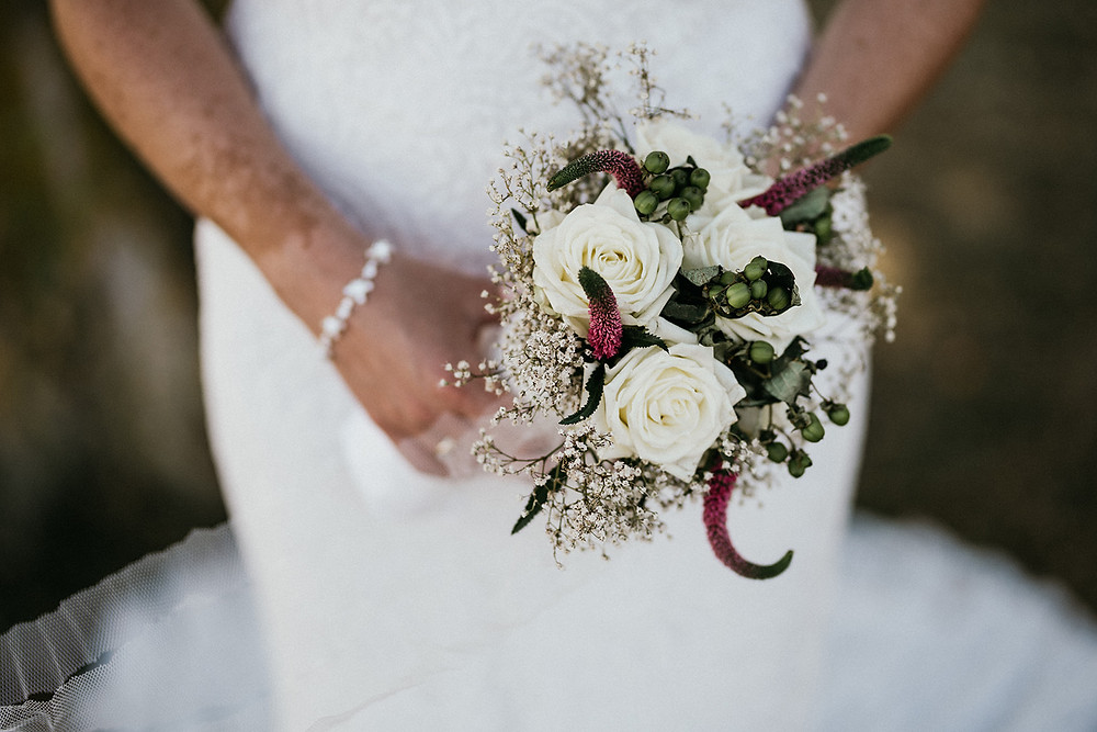 A wedding bouquet in the white colors.