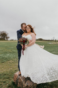a-groom-holds-a-bride-at-the-outdoor