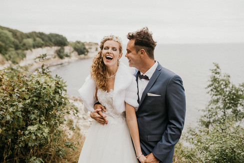 A groom smiling and looking at his bride during their wedding abroad adventure in Denmark, one of the best places to get married in Denmark
