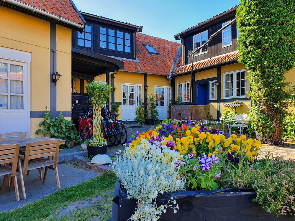A typical cozy yard in Allinge town where you can get married abroad in Denmark