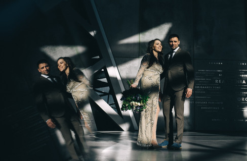 An artistic portrait of a couple while they renew vows abroad in Denmark in a breathtaking contemporary building, a lovely Denmark wedding venue as well.