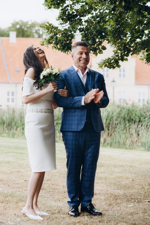 Newlyweds laughing and having a great time on their Denmark elopement packages