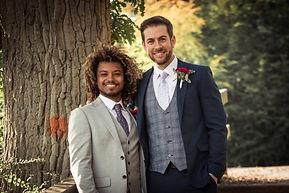 Two grooms posing in camera