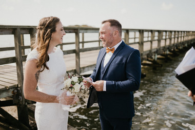 A bride and groom talking during their Scandinavian wedding in Denmark by the beach