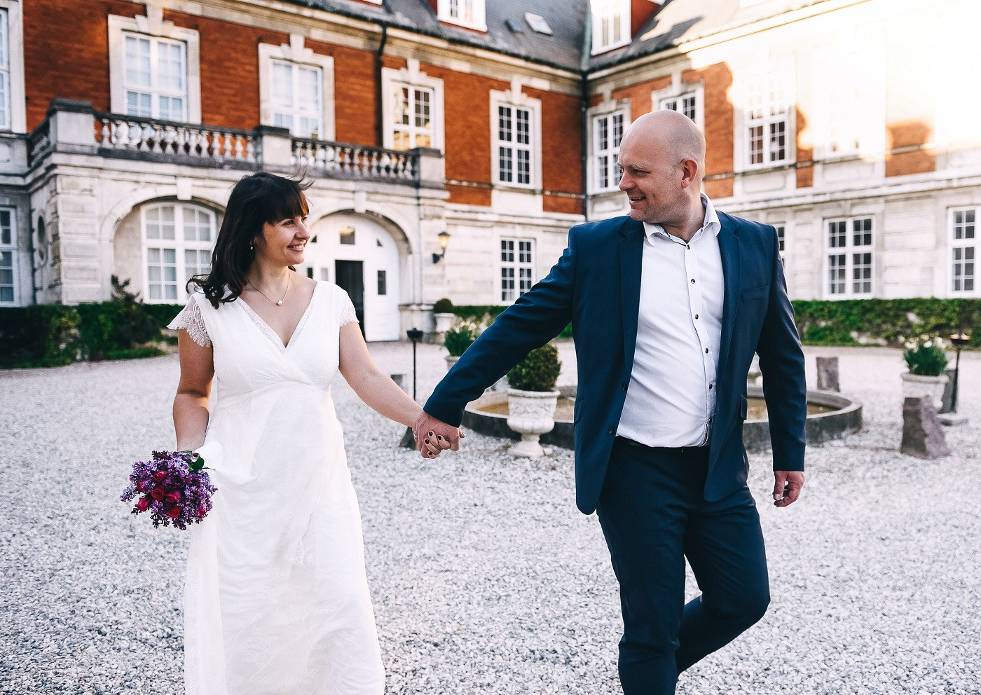 Marina & Daniel eloping abroad for their castle wedding at the Hvedholm Castle.