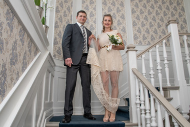Husband and wife during their adventure elopement to Denmark, pictured at the Bandholm Hotel lobby as they getting married in Denmark