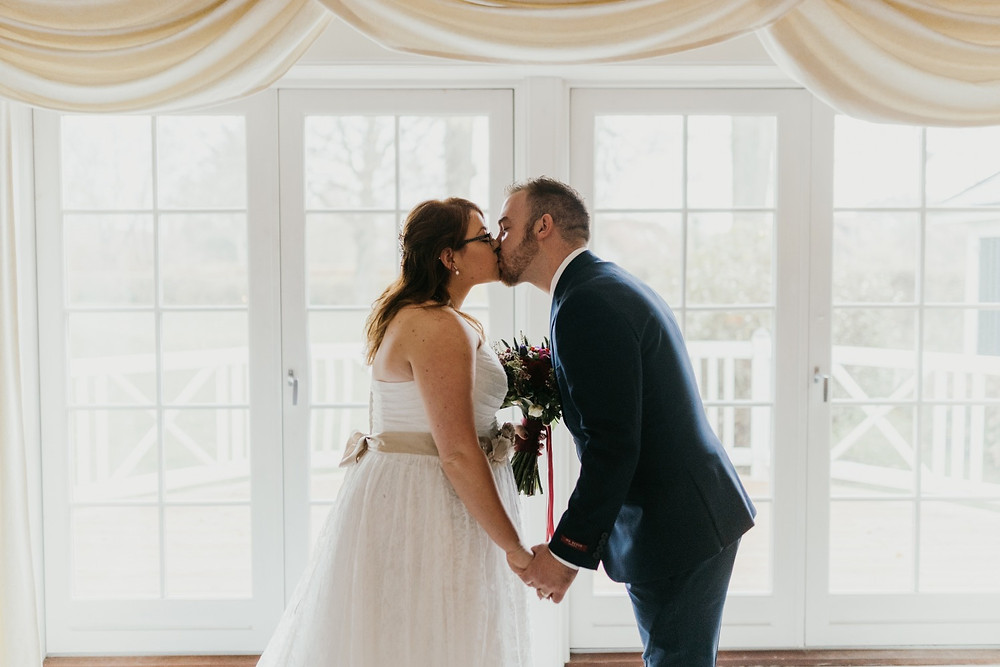 Courtney & Patryk kissing during their fast marriage in Denmark.