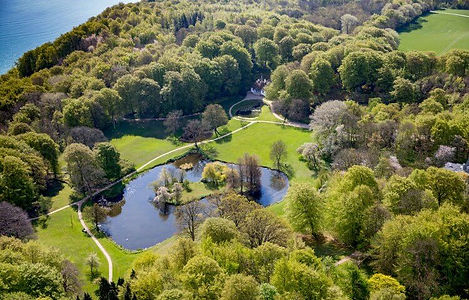 An aerial view of Liselund Park on Møn Island, a romantic destination wedding venue in Denmark, perfect for adventure elopements abroad.