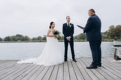 A micro wedding by the Maribo Lake, a couple getting married in Denmark outdoors