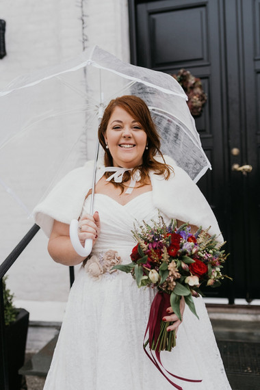 A bride smiling with joy during her adventure elopement to Lolland Island, made possible by our Denmark wedding packages abroad for two.