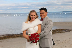 The couple on the beach after their wedding in Denmark