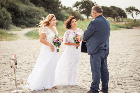 A gay marriage ceremony by the beach in Denmark, pictured a lesbian couple getting married in Denmark.