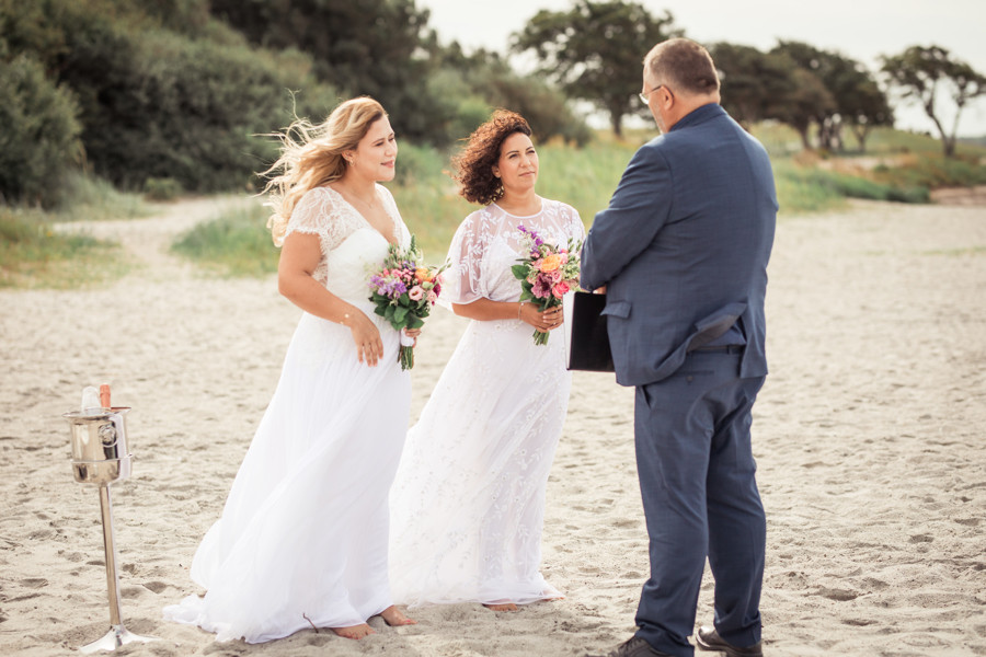 Same sex couple getting married on the beach on Danish island of Lolland