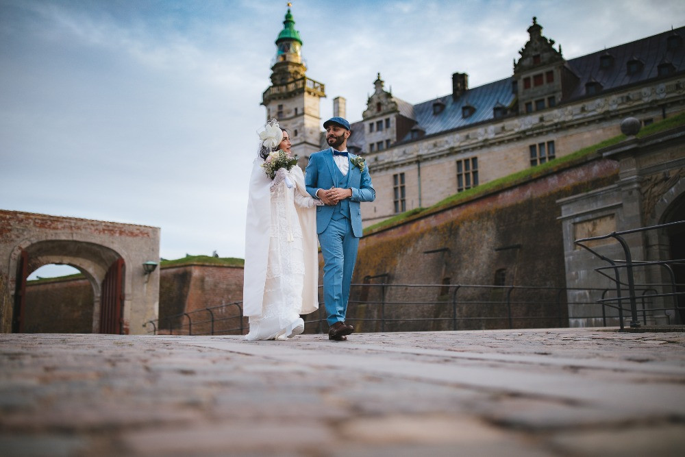 Couple walking from Elsinore castle after their wedding ceremony in the castle
