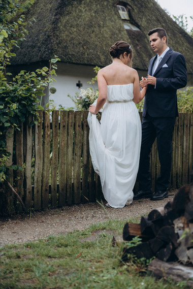 Newlyweds on their Denmark wedding at the open-air museum, enjoying their eco-style wedding in fashion, one of the most intimate and best places to elope in Denmark.