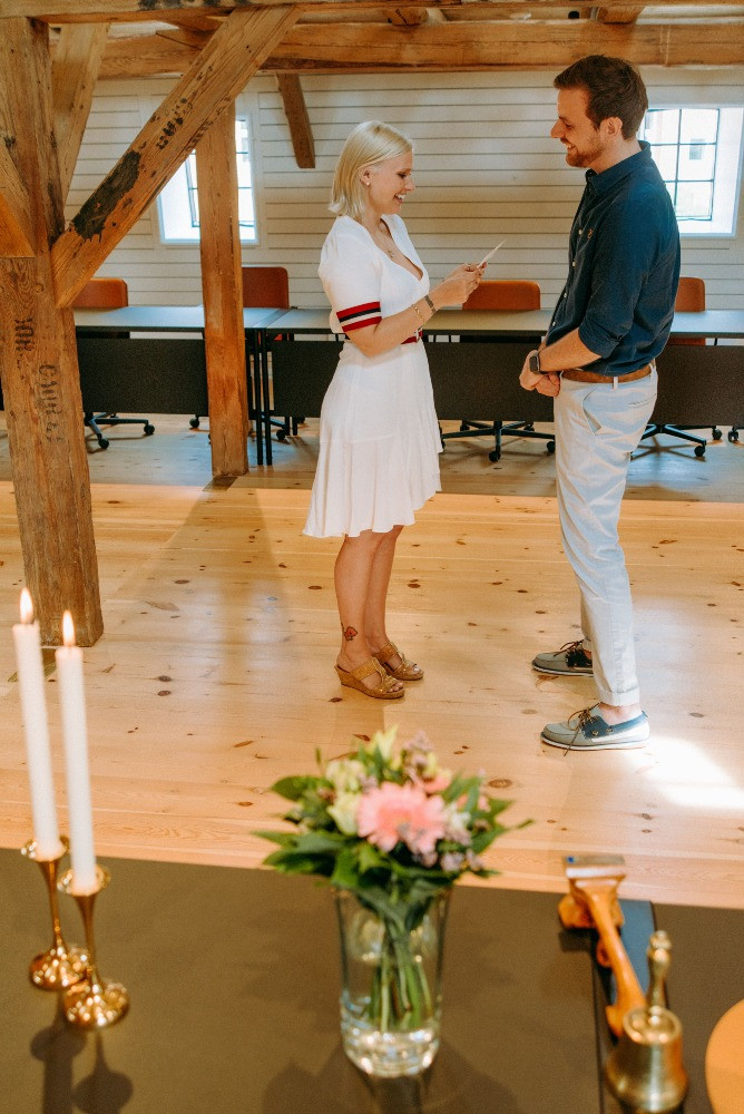 A bride reads her vows during their wedding in Denmark
