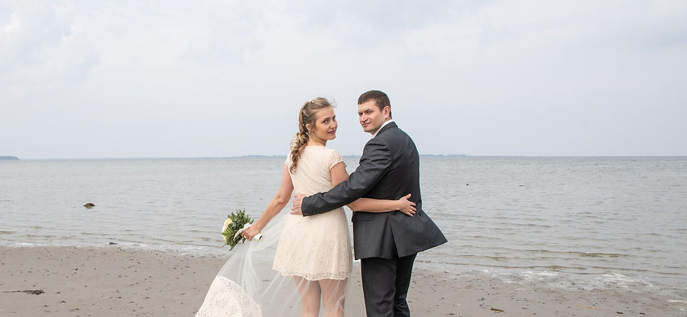 Newlyweds embracing by the beach as they enjoy their Denmark wedding