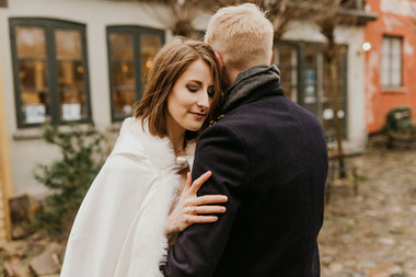 A romantic moment as the bride embraces the groom during their winter elopement to Mon Island as they get married in Denmark