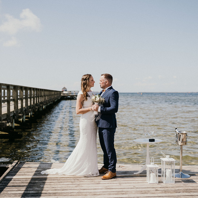 A couple saying their vows on the wedding island of Lolland-Falster, one of the most relaxing Danish island wedding locations