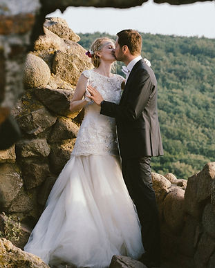 A couple kissing on the cliff top of the Bornholm island, during their adventure elopement