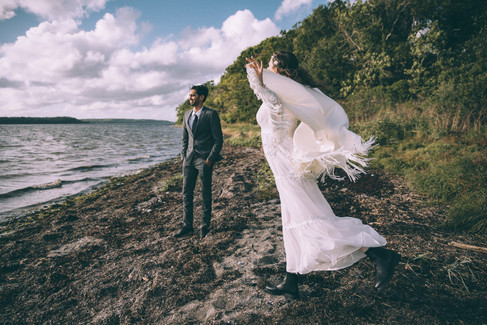 Newlyweds enjoying their time at a romantic beach in Denmark, one of the best places to get married abroad.