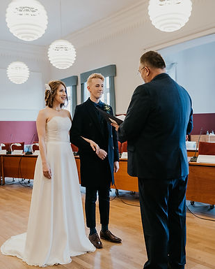 Civil weddings mean you need to collect the required documents to get married in Denmark like this couple did before their town hall elopement.