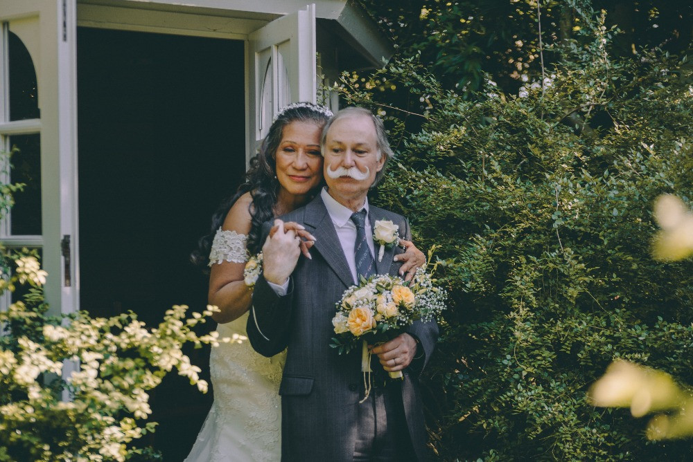 A romantic picture of senior newlyweds after their wedding in denmark on lolland island