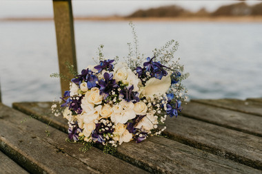 A bouquet of white and blue flowers, one of the many details that go into planning a Scandinavian wedding in our Denmark