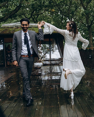 Newlyweds dancing in the forest during their elopement in Denmark